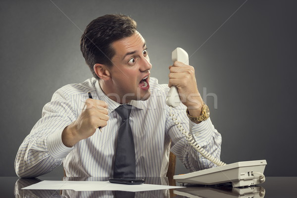 Furious businessman shouting on phone Stock photo © photosebia