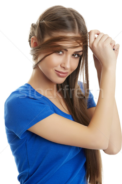 Gorgeous woman playing with hair Stock photo © photosebia