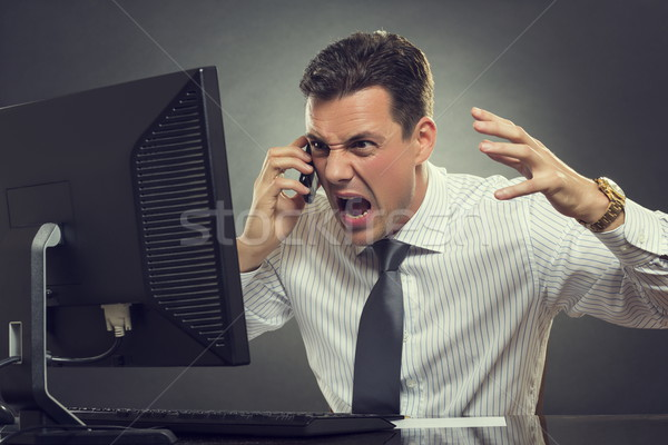 Angry businessman shouting on phone Stock photo © photosebia