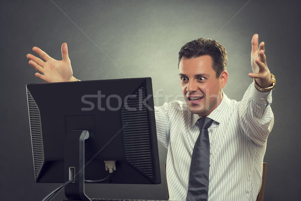 Thrilled businessman over great news Stock photo © photosebia