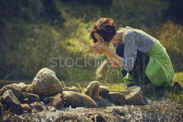Woman drinking creek fresh water Stock photo © photosebia