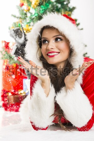 Smiling lady in Santa Claus outfit Stock photo © photosebia
