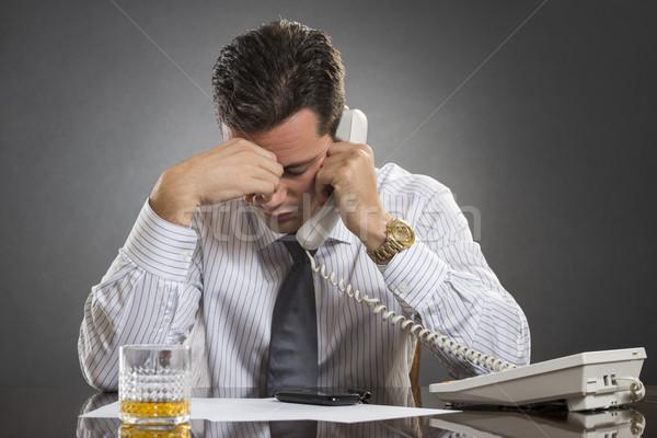 Stressed businessman with headache Stock photo © photosebia