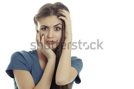 Co piękna młoda kobieta ręce głowie niespodzianką Zdjęcia stock © photosebia
