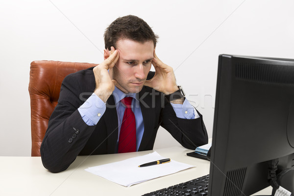Young concerned businessman  Stock photo © photosebia