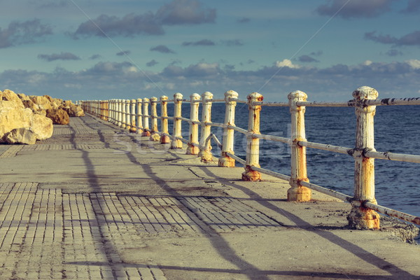 Weathered railings and seafront promenade Stock photo © photosebia
