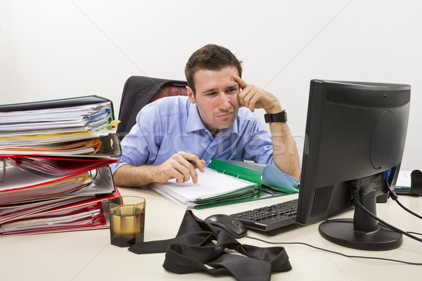 Confused accountant at work Stock photo © photosebia