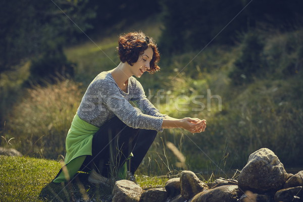 Woman washing hands in mountain stream water Stock photo © photosebia