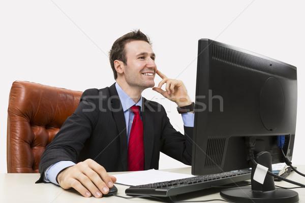 Handsome businessman smiling positively Stock photo © photosebia