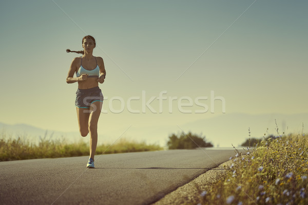 Sporty woman running Stock photo © photosebia