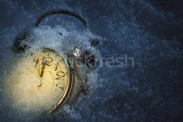 Alarm clok covered by snow Stock photo © photosebia