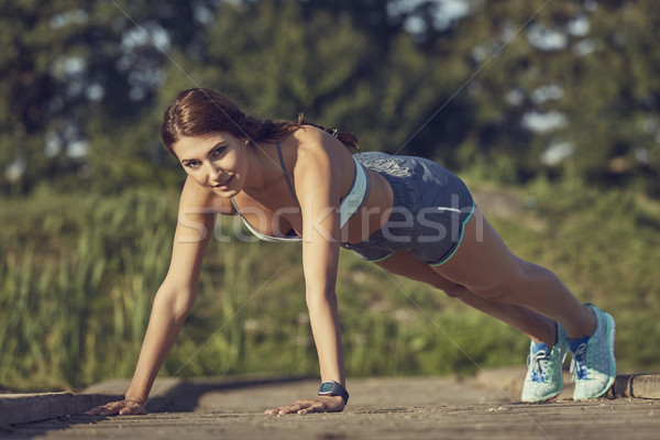 Young woman doing push-ups Stock photo © photosebia