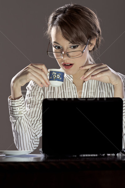 Drinking cofee and working on laptop Stock photo © photosebia