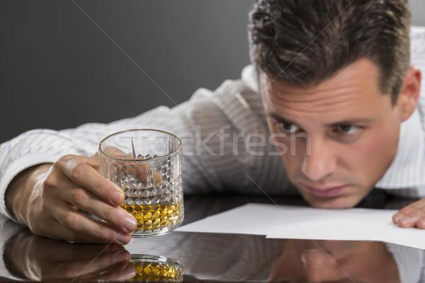Sad businessman drinking alcohol Stock photo © photosebia