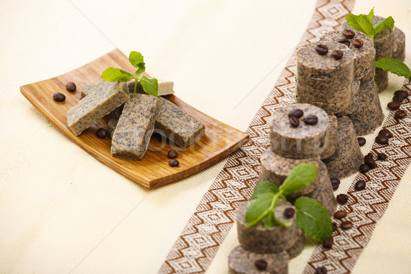 Stock photo: Handmade soap bars on wooden stand