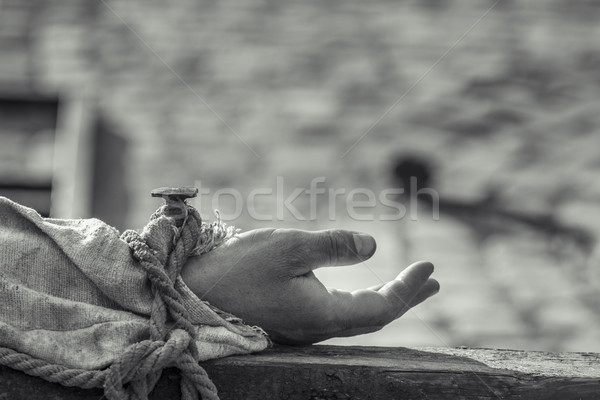 Stock photo: Nailed hand on wooden cross