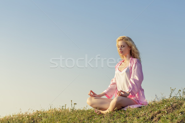 Stock photo: Blonde girl meditating in yoga pose