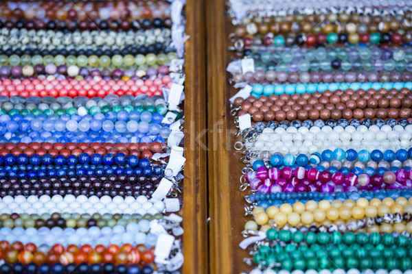 Wooden shelf with colorful necklaces Stock photo © photosebia