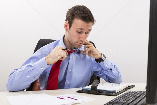 Stressed businessman having a hard day at office Stock photo © photosebia