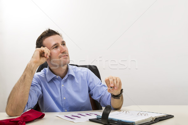 Thinking young entrepreneur at office Stock photo © photosebia