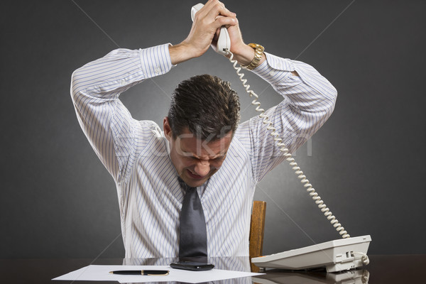 Businessman losing temper control Stock photo © photosebia