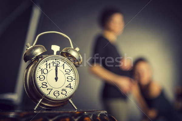 Pregnancy and alarm clock Stock photo © photosebia