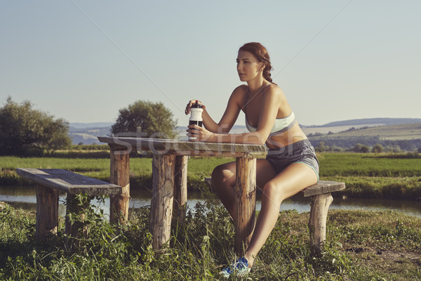 Woman hydrating after run Stock photo © photosebia