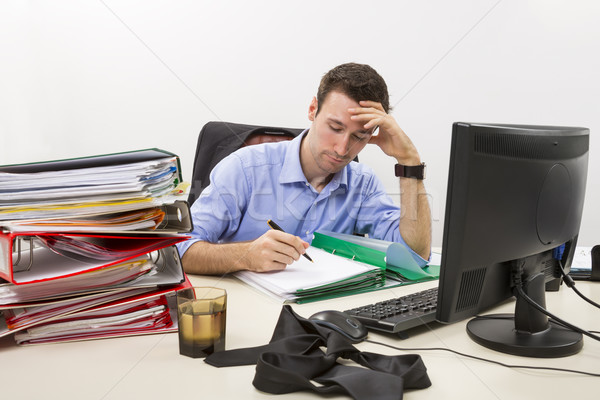 Confident businessman at work Stock photo © photosebia