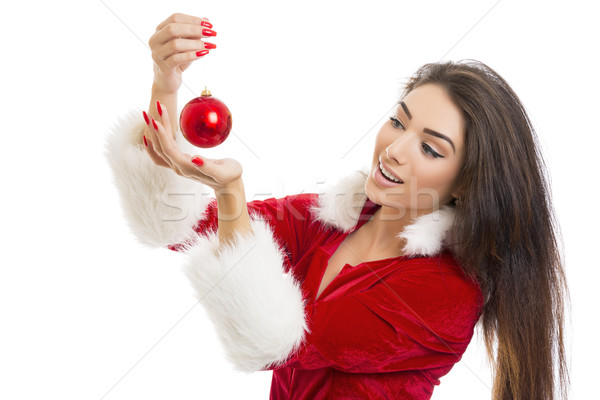 Delighted young woman holding red bauble Stock photo © photosebia