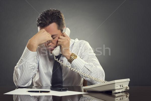 Overwhelmed  businessman with headache Stock photo © photosebia