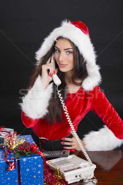 Santa girl answering the phone Stock photo © photosebia