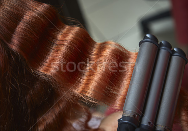 Red hair curled with triple barrel curling  iron Stock photo © photosebia