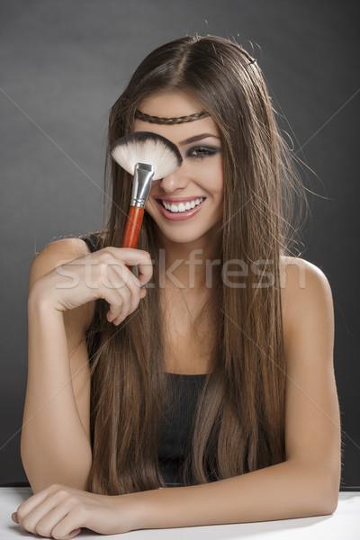 Jókedv sminkecset fiatal derűs nő szórakozás Stock fotó © photosebia