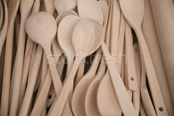 Stock photo: Group of wooden cooking spoons on stall.