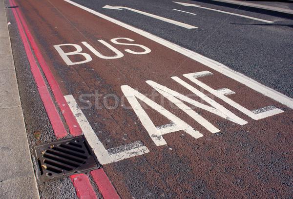 автобус полоса красный Стрелки направлении движения Сток-фото © photosil
