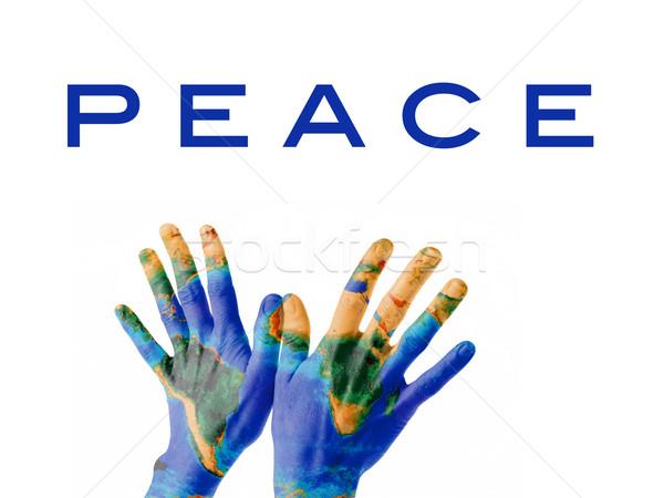Pace terra coppia mani posizione verniciato Foto d'archivio © photosil