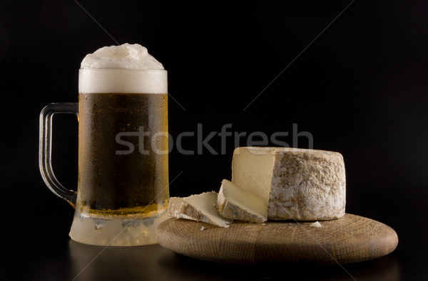 Foaming beer and cheese Stock photo © photosil