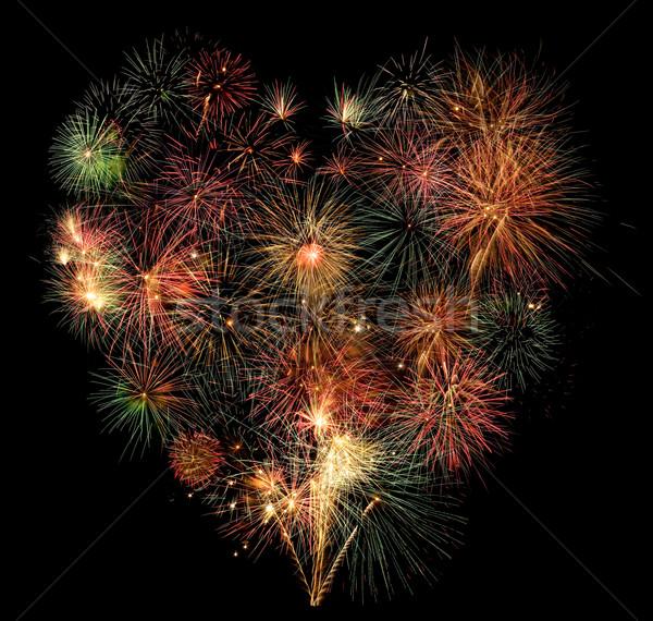 Coração fogos de artifício céu noturno luz fundo noite Foto stock © photosil