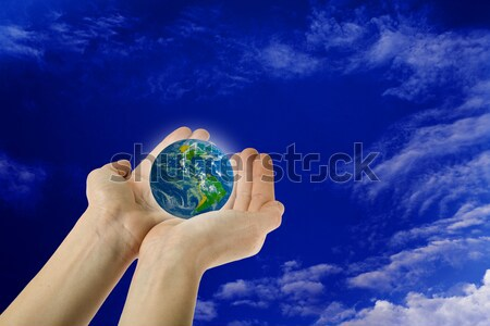 Terra mani profondità cielo blu Foto d'archivio © photosil