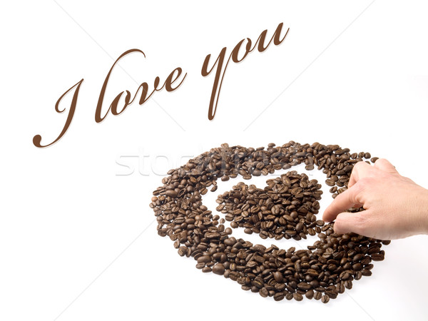 Hand designing a heart with coffee beans Stock photo © photosil