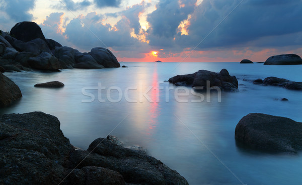 Sunset in rocky beach Stock photo © photosoup