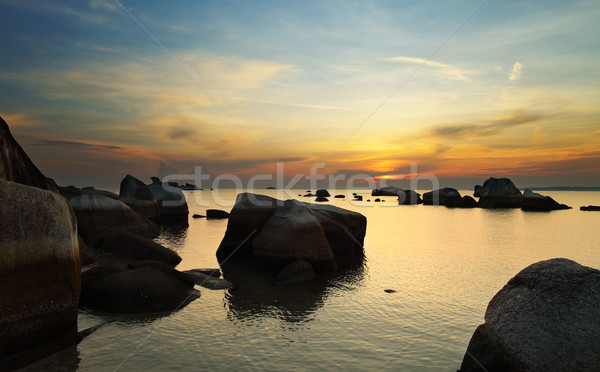 Sunrise in rocky island Stock photo © photosoup
