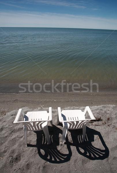 lawn chairs on beach of Lake Winnipeg Stock photo © pictureguy