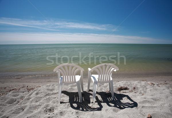 lawn chairs along beach of Lake Winnipeg Stock photo © pictureguy