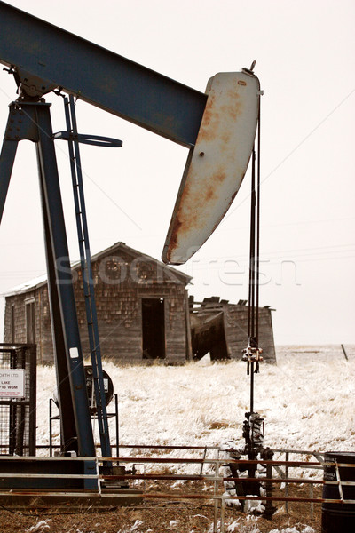 Pump jack near abandoned homestead Stock photo © pictureguy