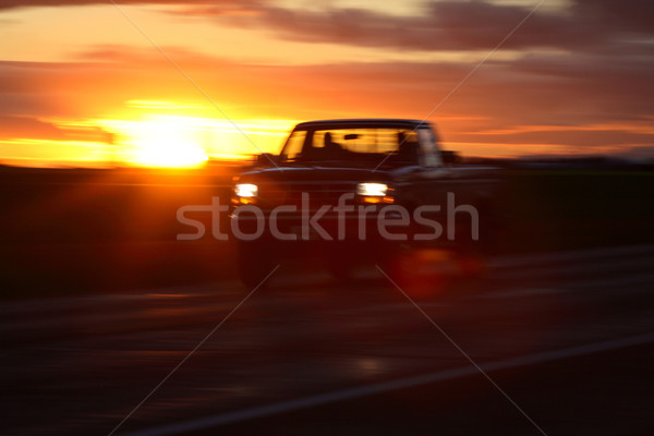 Sunset behind a passing car in scenic Saskatchewan Stock photo © pictureguy
