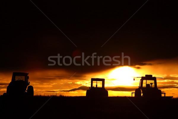 Sunrise behind farm machinery Saskatchewan Stock photo © pictureguy