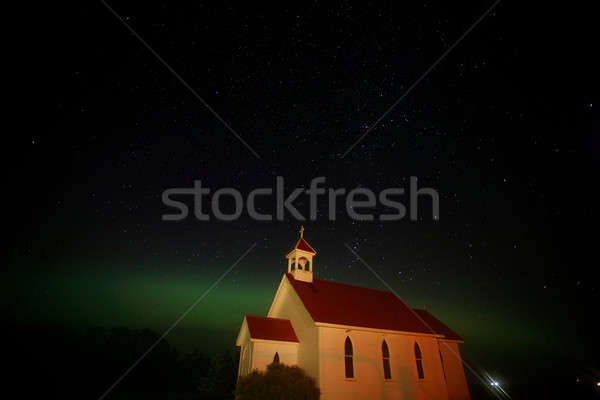 Northern Lights and star tracks over Saint Columba church Stock photo © pictureguy
