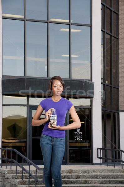 Woman Holding Her Retirement Account Stock photo © piedmontphoto