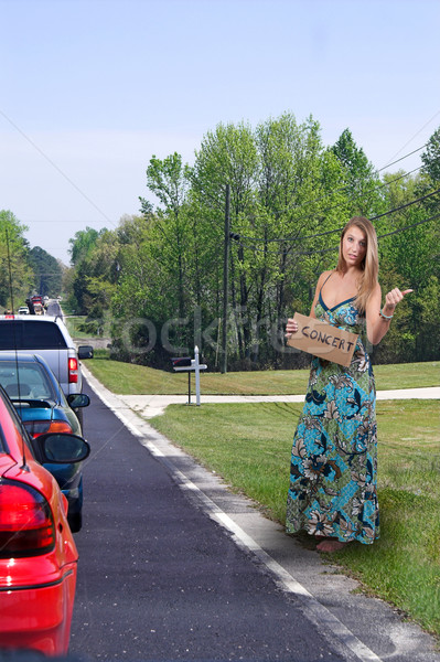 Woman Hitch Hiking to a Concert Stock photo © piedmontphoto